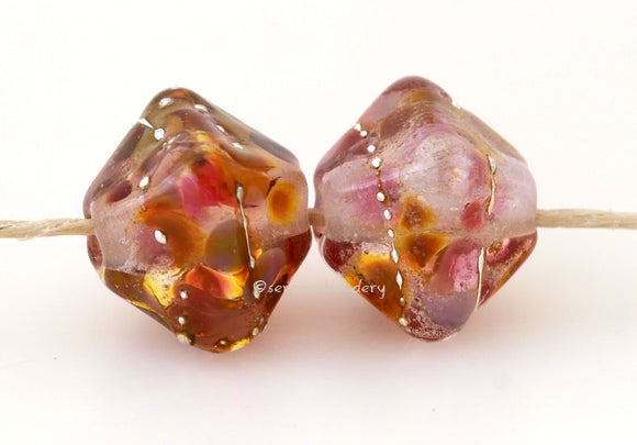 The Desire Crystal Pair #1776 Size: 13x13 mm ~ Amount: 2 Beads ~ Hole Size: 2.5 mm~ pink, peach and golden brown crystals with fine silver ~ These beads are ready to ship. Default Title