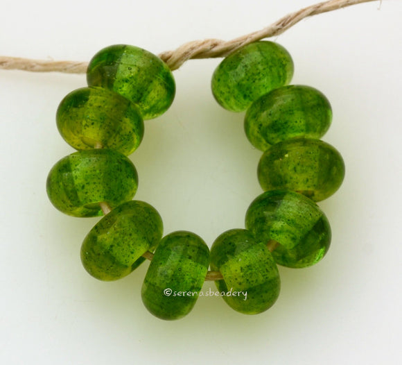 Lemon Lime Sparkle Spacers #1786 Size: 6x10 mm ~ Amount: 10 beads ~ Hole Size: 2.5 mm~ An out of production color that is loaded with glitter. Glossy finish. ~ These beads are ready to ship. Default Title