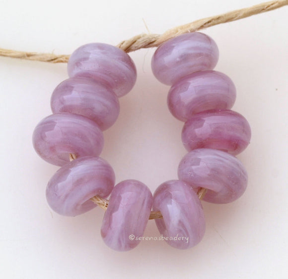 Pretty in Pink Spacers #1790 Size: 6x10 mm ~ Amount: 10 beads ~ Hole Size: 2.5 mm~ An out of production color in ghosty streak pink. Glossy finish. ~ These beads are ready to ship. Default Title