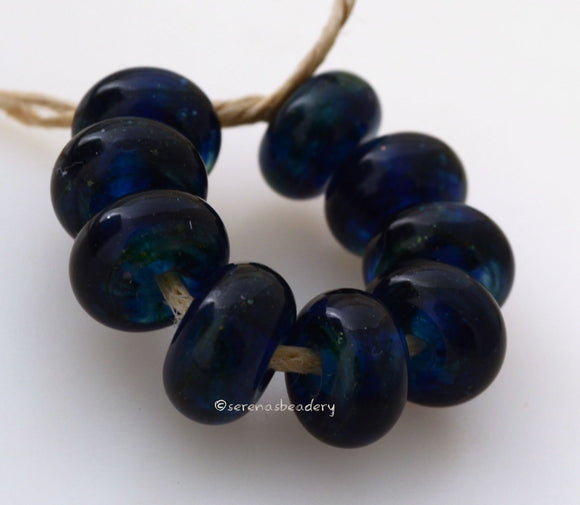 Deep Blue Algae Spacers #1795 Size: 6x10 mm ~ Amount: 9 beads ~ Hole Size: 2.5 mm~ An out of production color that is deep blue with green. Glossy finish. ~ These beads are ready to ship. Default Title