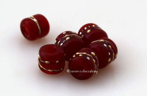 Tiny Tube Red Fine Silver Dots red tube-shaped lampwork glass beads decorated with fine silver dotsThe last picture shows these in my hand for size reference. They are tiny tiny tiny!!~~~~~~~~~~~~~~~~~~~~~~~~~~6x6 mm6 Beads1.5 mm hole Default Title