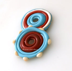 Southwest Disks #1893 Size: 3x28 mmAmount: 2 BeadsHole Size: 2.5 mm Turquoise, ivory, coral and a bit of fine silver in large disks. These disks are ready to ship! Default Title
