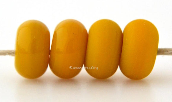 Ocher Limited Edition Color Notes: Available shapes and sizes:Round Bead Shapes: Available to order 8 to 15 mm with hole sizes ranging from 1.5 to 5 mm. See drop down menu for the exact options. Shown here in 8, 9 and 10 mm with both a 2.5 mm and 1.5 mm hole. 4 and 5 mm holes will fit European Charm style jewelry.Also available in a wavy disk or bead cap:. Pressed bead shapes:Lentil - 12x13 mm in size with a 1.5mm hole.: Pillow 13 mm square with a 1.5 mm hole.: Tab: Default Title