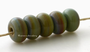 Dragon Spacers #1966 5 Dragon spacers, opaque green with hints of brown - 5x10 mm with a 2.5 mm hole, glossy finish. This handmade bead set is ready to ship! Default Title