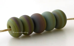 Dragon Matte Spacers #1967 5 Dragon spacers, opaque green with hints of brown - 5x10 mm with a 2.5 mm hole, matte finish. This handmade bead set is ready to ship! Default Title