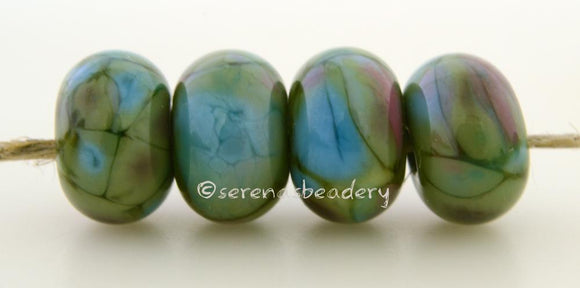 Icing on the Cake Olive green lampwork glass beads with turquoise pink and deep olive frit..Bead Size: 6x11-12 or 7x13-14 mmHole Size: 2.5 mmprice is for one bead with a discount for 4 or more 11-12 mm,Glossy,13-14 mm,Glossy,11-12 mm,Matte,13-14 mm,Matte