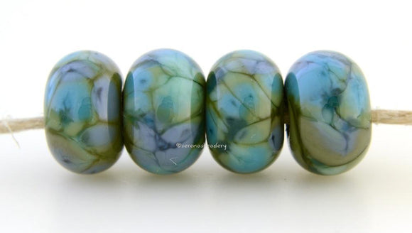 Green Olive Boogie Opaque olive green with blue and turquoise boogie frit.Bead Size: 6x11-12 or 7x13-14 mmHole Size: 2.5 mmprice is for one bead with a discount for 4 or more 11-12 mm,Glossy,13-14 mm,Glossy,11-12 mm,Matte,13-14 mm,Matte