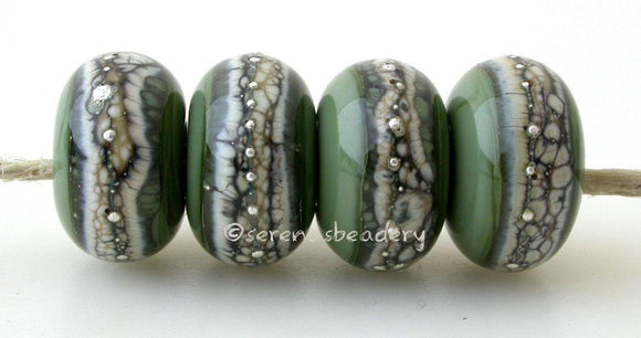 Olive Green Granite with Fine Silver Olive green wrapped in silvered ivory and fine silver droplets. 5x11 mm 2.5 mm hole Price is per bead with discounts for larger quantities. Glossy,Matte