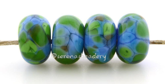 Leaping Water Blue and bright green and a bit of brown lampwork glass beads.Bead Size: 6x11-12 or 7x13-14 mmHole Size: 2.5 mmprice is for one bead with a discount for 4 or more 11-12 mm,Glossy,13-14 mm,Glossy,11-12 mm,Matte,13-14 mm,Matte