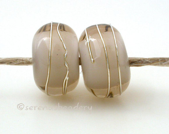 Pale Brown Age Old A layer of pale brown over white with a silver wrap.   6x12 mm with a 2.5 mm hole. Price is per bead. Glossy,Matte