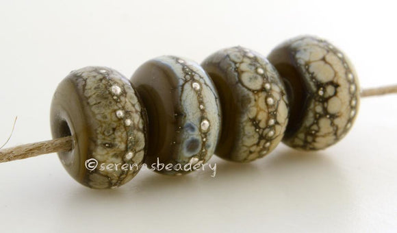 Deep Gray Granite with Fine Silver Deep gray wrapped in silvered ivory and fine silver droplets. 5x11 mm 2.5 mm hole Price is per bead with discounts for larger quantities. Glossy,Matte