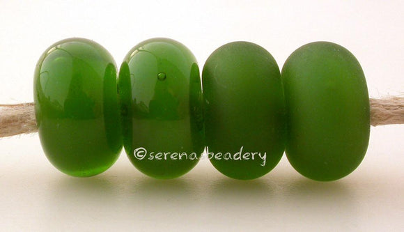 Mystic Green Color Notes: Mystic colors have a wonderful almost vintage givre look to them. There is a streak of opaque color within the transparent color. 5x10 mm Available shapes and sizes:Round Bead Shapes: Available to order 8 to 15 mm with hole sizes ranging from 1.5 to 5 mm. See drop down menu for the exact options. Shown here in 8, 9 and 10 mm with both a 2.5 mm and 1.5 mm hole. 4 and 5 mm holes will fit European Charm style jewelry.Also available in a wavy disk or bead cap:. Pressed bead shapes:Lent