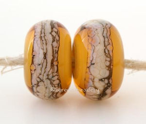 Amber Granite White Heart An amber white heart bead with a stripe of silvered ivory granite6x12 mmprice is per bead Glossy,Matte