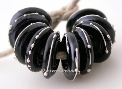 Black Fine Silver Disks A set of black discs wrapped in fine silver. 3x14mm Glossy,Matte