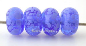 Spotted Blue Periwinkle Transparent blue beads covered in periwinkle blue colored frit. The picture shows them in both glossy and matte.Bead Size: 6x11-12 or 7x13-14 mmHole Size: 2.5 mmprice is for one bead with a discount for 4 or more 11-12 mm,Glossy,13-14 mm,Glossy,11-12 mm,Matte,13-14 mm,Matte