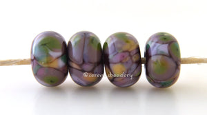 Twilight Blossom Deep purple lampwork glass beads with green, lilac, pink, plum, mauve and peach.Bead Size: 6x11-12 or 7x13-14 mmHole Size: 2.5 mmprice is for one bead with a discount for 4 or more 11-12 mm,Glossy,13-14 mm,Glossy,11-12 mm,Matte,13-14 mm,Matte