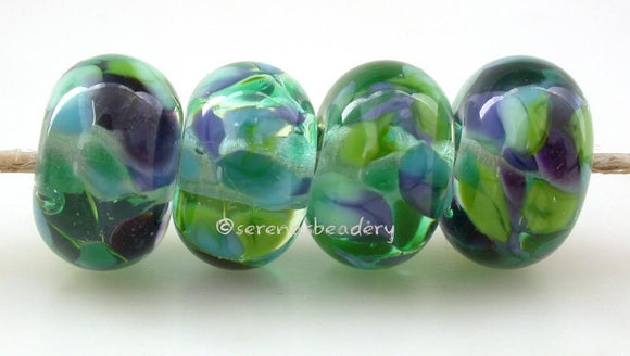Jungle Gem Crystal clear lamwork glass beads with blue green and purple frit.Bead Size: 6x11-12 or 7x13-14 mmHole Size: 2.5 mmprice is for one bead with a discount for 4 or more 11-12 mm,Glossy,13-14 mm,Glossy,11-12 mm,Matte,13-14 mm,Matte