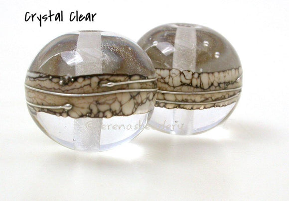Saw Whet Silvered Ivory Rounds 2 different colors separated by silvered ivory and drizzled with fine silver in a super round shape.There are many color choices in the drop down menu to the right. Only choose custom if you want to order the new color combination we have been discussing.Approximately 10x12 mm or 13x15 mm Price is per bead. Crystal Clear,Glossy,12 mm,Crystal Clear,Glossy,15 mm,Crystal Clear,Matte,12 mm,Crystal Clear,Matte,15 mm,Amethyst/Sepia,Glossy,12 mm,Amethyst/Sepia,Glossy,15 mm,Amethyst/S