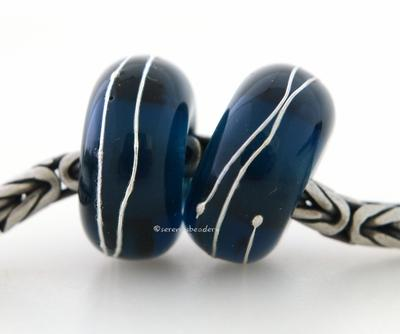 Dark Denim Fine Silver Wrap European Charm Bead one dark denim handmade lampwork glass European charm spacer bead with a fine silver wrap6x14 mm with a 5mm holeprice is per bead Glossy,Matte