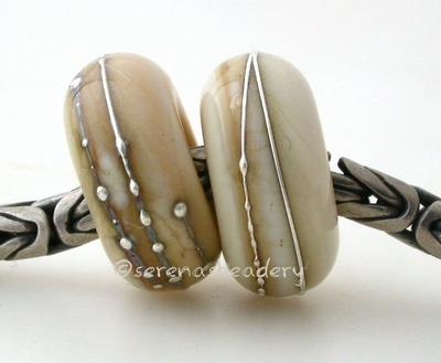 Dark Ivory Fine Silver Wrap European Charm Bead one dark ivory handmade lampwork glass European charm spacer bead with a fine silver wrap6x14 mm with a 5mm holeprice is per bead Glossy,Matte