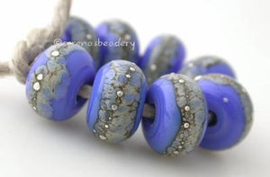 Dark Periwinkle Granite with Fine Silver Dark Periwinkle Blue wrapped in silvered ivory and fine silver droplets. 5x11 mm 2.5 mm hole Price is per bead with discounts for larger quantities. Glossy,Matte