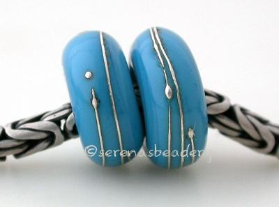 Dark Turquoise Fine Silver Wrap European Charm Bead one dark turquoise handmade lampwork glass European charm spacer bead with a fine silver wrap6x14 mm with a 5mm holeprice is per bead Glossy,Matte