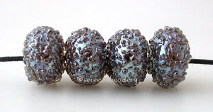 Ekho Luster Sugar Just like the silver disco ball luster sugar but with a base of ekho. This gives them a bit more of a golen amber hue.   Bead Size: 6x12 mm Hole Size: 1.5 mm price is for one bead with a discount for 4 or more   Glossy,Matte