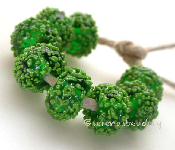 Emerald Sugar Emerald green beads covered in bright green sugar frit   Bead Size: 6x12 mm Hole Size: 2.5 mm price is for one bead with a discount for 4 or mores Glossy,Matte