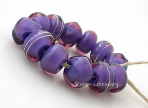 Fairy Fabulous a dark periwinkle base cased in amethyst purple6x12 mmprice is per bead Glossy,Matte