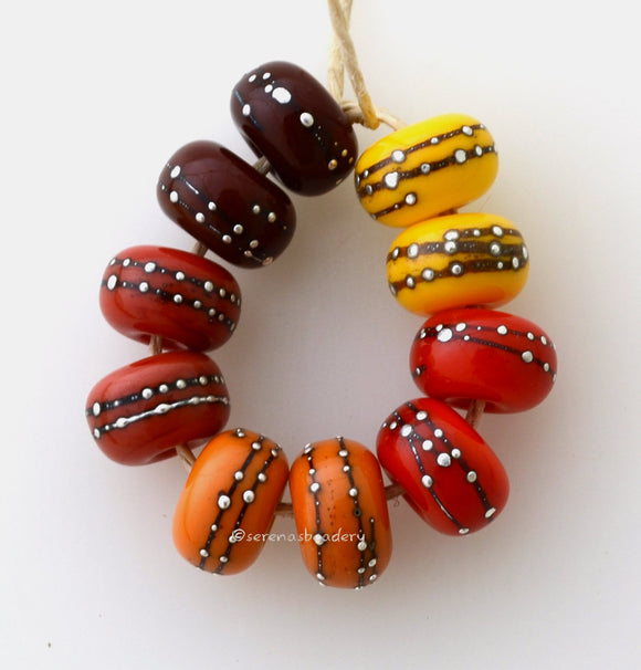 Fall Harvest Fall Harvest colors with fine silver droplets. Choose one pair or the set of 10 beads. The colors are brown, red, deep orange, light orange, and bright yellow.Bead Size: 6x11 mmAmount: 2 or 10 BeadsHole Size: 2.5 mm Glossy,Brown,Glossy,Red,Glossy,Deep Orange,Glossy,Light Orange,Glossy,Yellow,Glossy,Set of 5 Pairs,Matte,Brown,Matte,Red,Matte,Deep Orange,Matte,Light Orange,Matte,Yellow,Matte,Set of 5 Pairs