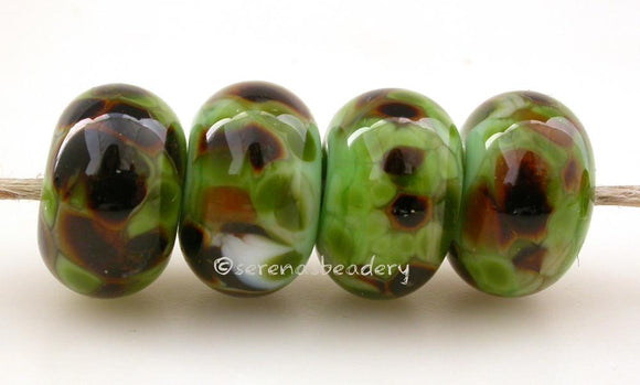 Grass Savannah Mint grass green lampwork glass beads with savannah frit.Bead Size: 6x11-12 or 7x13-14 mmHole Size: 2.5 mmprice is for one bead with a discount for 4 or more 11-12 mm,Glossy,13-14 mm,Glossy,11-12 mm,Matte,13-14 mm,Matte