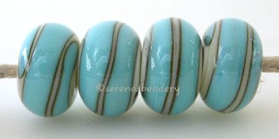 Ivory Turquoise Spiral light ivory beads with a turquoise spiral6x12 mmprice is per bead Glossy,Matte