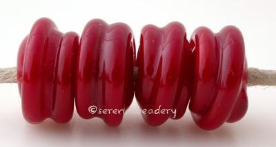Light Red Raised Spirals light red beads with a raised spiral6x12 mmprice is per bead Glossy,Matte