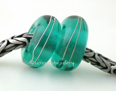 Light Teal Fine Silver Wrap European Charm Bead one light teal handmade lampwork glass european charm spacer bead with a fine silver wrap5x13mm with a 5mm holeprice is per bead Glossy,Matte