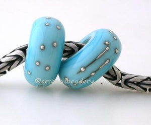 Light Turquoise Fine Silver Wrap European Charm Bead one light turquoise handmade lampwork glass european charm spacer bead with a fine silver wrap5x13mm with a 5mm holeprice is per bead Glossy,Matte