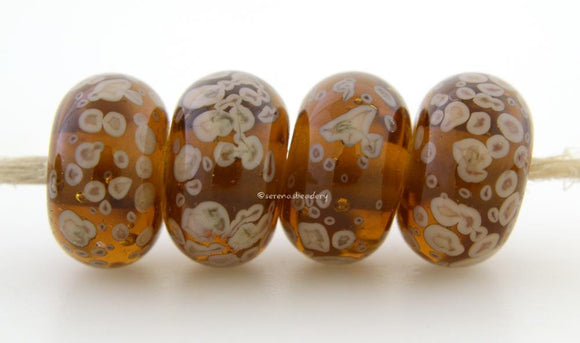 Maple Latte Maple brown lampwork glass beads with creamy latte frit.Bead Size: 6x11-12 or 7x13-14 mmHole Size: 2.5 mmprice is for one bead with a discount for 4 or more 11-12 mm,Glossy,13-14 mm,Glossy,11-12 mm,Matte,13-14 mm,Matte