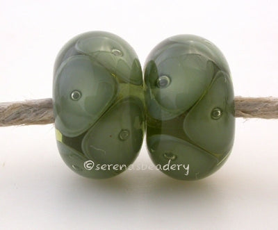 Mojito and Olive Green Bubbles mojito and olive green bubbles 7x12 mm 2.5mm hole price is per bead All of my lampwork glass beads are individually handmade using Effetre, Vetrofond, or Lauscha, Reichenbach, Double Helix, and Bullseye glass rods. They are annealed in a digitally controlled kiln for everlasting strength and durability. Default Title