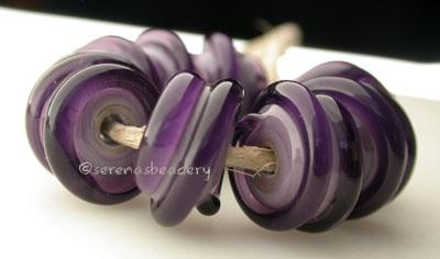 Double Purple Raised Spiral New Violet beads with a dark violet raised spiral. 6x12 mm price is per bead Default Title