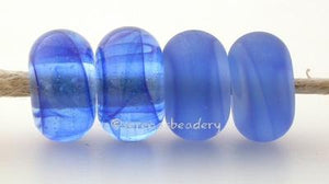 Ocean Color Notes: Streaky wispy blue 5x10 mm Available shapes and sizes:Round Bead Shapes: Available to order 8 to 15 mm with hole sizes ranging from 1.5 to 5 mm. See drop down menu for the exact options. Shown here in 8, 9 and 10 mm with both a 2.5 mm and 1.5 mm hole. 4 and 5 mm holes will fit European Charm style jewelry.Also available in a wavy disk or bead cap:. Pressed bead shapes:Lentil - 12x13 mm in size with a 1.5mm hole.: Pillow 13 mm square with a 1.5 mm hole.: Tab: Default Title