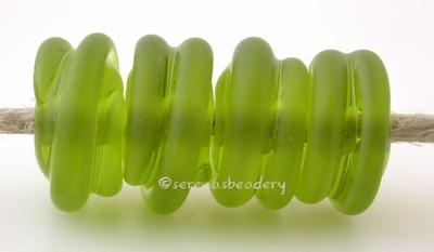 Olive Tumbled Raised Spirals transparent olive green beads with a raised spiral - tumbled for a soft matte finish with glossy highlights6x12 mmprice is per bead Default Title