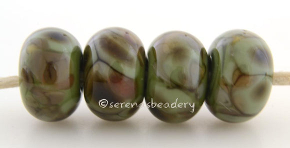 Olive Groves Olive green lampwork glass beads with green, brown, and rust frit.Bead Size: 6x11-12 or 7x13-14 mmHole Size: 2.5 mmprice is for one bead with a discount for 4 or more 11-12 mm,Glossy,13-14 mm,Glossy,11-12 mm,Matte,13-14 mm,Matte