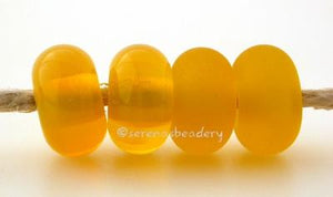 Opal Yellow Color Notes: a smoky bright yellow 5x10 mm Available shapes and sizes:Round Bead Shapes: Available to order 8 to 15 mm with hole sizes ranging from 1.5 to 5 mm. See drop down menu for the exact options. Shown here in 8, 9 and 10 mm with both a 2.5 mm and 1.5 mm hole. 4 and 5 mm holes will fit European Charm style jewelry.Also available in a wavy disk or bead cap:. Pressed bead shapes:Lentil - 12x13 mm in size with a 1.5mm hole.: Pillow 13 mm square with a 1.5 mm hole.: Tab: Default Title