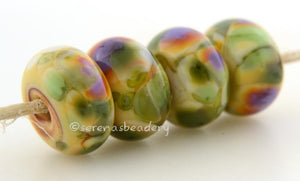 Canyon Morning Pale yellow lampwork glass beads with green and purple frit.Bead Size: 6x11-12 or 7x13-14 mmHole Size: 2.5 mmprice is for one bead with a discount for 4 or more 11-12 mm,Glossy,13-14 mm,Glossy,11-12 mm,Matte,13-14 mm,Matte