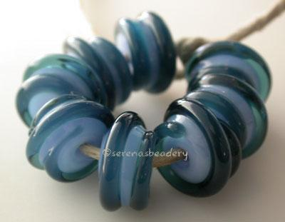 Double Blue Raised Spiral Periwinkle blue with a leaky pen raised spiral. 6x12 mm price is per bead Default Title