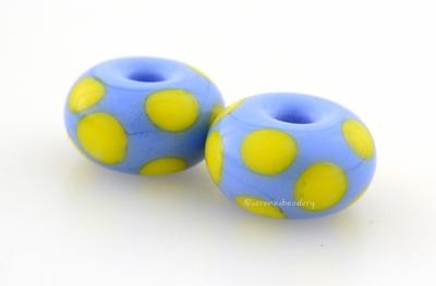 Periwinkle Yellow Dice Dots A periwinkle base with bright acid yellow dice dots. 5x11 mm price is per bead Glossy,Matte