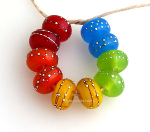 Assorted Popsicles A set of 5 pairs in red, orange, yellow, green and blue. Ive chosen the brightest neon shades of each color that I could find in my stock. This fun rainbow assortment is similar to an assorted pack of popsicles. Each silver wrap is carefully burnished onto the glass bead while it is still hot. Bead Size: 6x11 mm Amount: 10 Beads Hole Size: 2.5 mm Also available in a 7x14 mm size for .00 extra. Glossy,6x11mm,Glossy,7x14mm,Matte,6x11mm,Matte,7x14mm