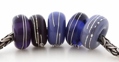 Purple Sampler Fine Silver Wrap European Charm Bead one sampler set of purple handmade lampwork glass european charm spacer bead with a fine silver wraps - The colors are grape, thai orchid, lilac purple, ink blue and lavender blue. 5x13mm with a 5mm holeprice is per 5 bead set Default Title