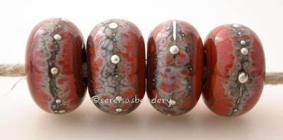 Red Rock Granite with Fine Silver Red Rock wrapped in silvered ivory and fine silver droplets. 5x11 mm 2.5 mm hole Price is per bead with discounts for larger quantities. Glossy,Matte