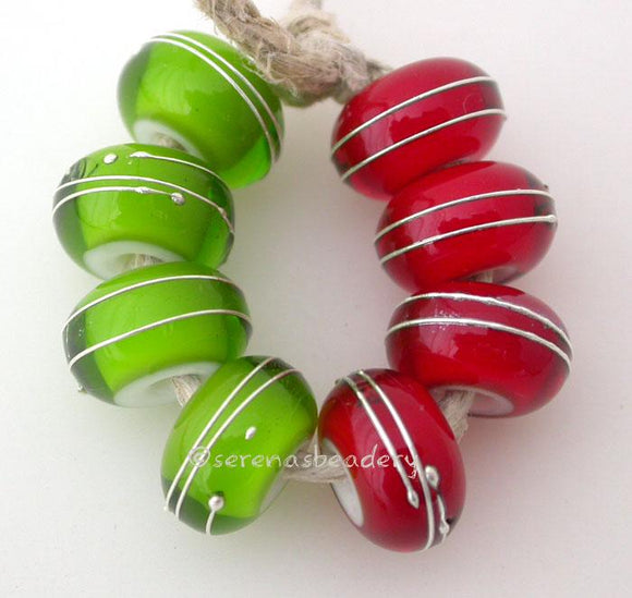 Green & Red Fine Silver Wraps A set of dark grass green and red white heart bead wrapped with strands of fine silver. 6x12 mm price is per 8 bead set Glossy,Matte