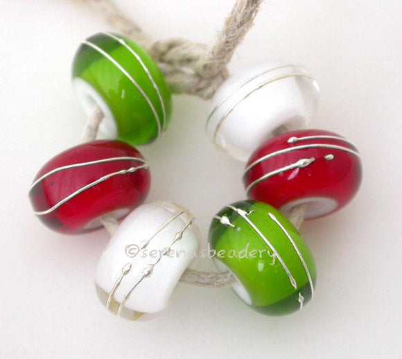 Green, Red & Clear Fine Silver Wraps A set of dark grass green, red and cyrstal clear white heart bead wrapped with strands of fine silver. 6x12 mm price is per 6 bead set Glossy,Matte